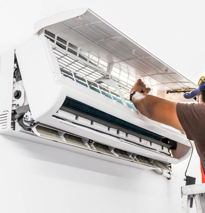 HVAC technician fixing Ductless Air Systems